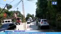 保亭:大货车忘收后斗 挂到电线进退两难