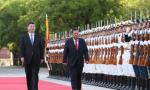 习近平同老挝人革党中央总书记、国家主席本扬举行会谈