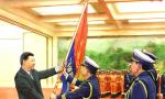 一年前,习近平向这支主力军和国家队授旗并致训词