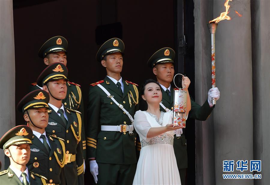 (體育)(5)第七屆世界軍人運動會圣火火種采集和火炬傳遞啟動儀式在南昌舉行