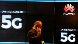 默克尔回应华为参与德国5G:不会排除特定国家和特定企业