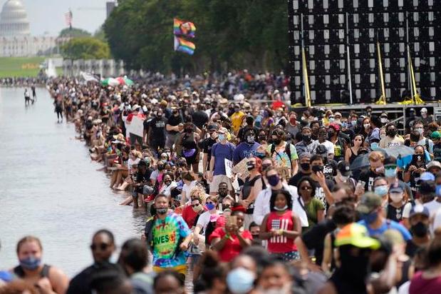 """美国非裔民众在线纪念""""百万人游行""""25周年 呼吁消除种族歧视"""